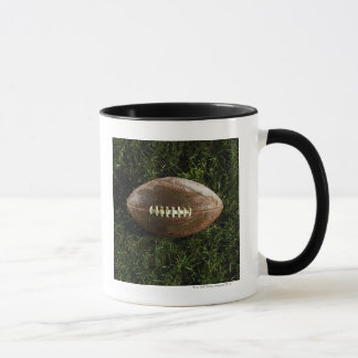 American football on grass, view from above mug