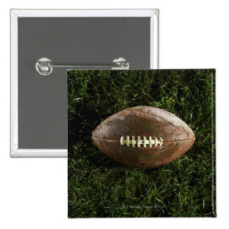 American football on grass, view from above pinback button