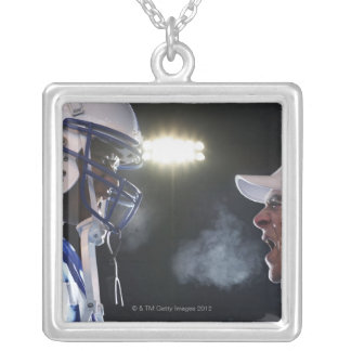 American football player and referee arguing, square pendant necklace