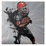 American football player holding football large square tile