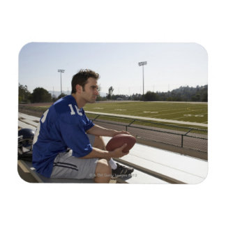 American football player sitting on bleachers magnet