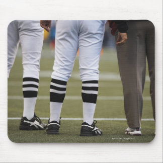 American football players and coach standing on mouse pad