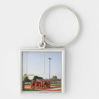 American football players, including teenagers keychain