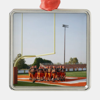 American football players, including teenagers metal ornament