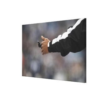 American football referee holding whistle, stretched canvas prints
