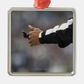 American football referee holding whistle, metal ornament