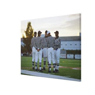 American football referees talking in field canvas print