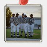 American football referees talking in field metal ornament