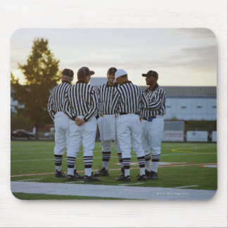 American football referees talking in field mouse pad