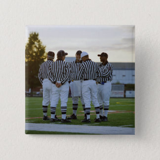 American football referees talking in field pinback button