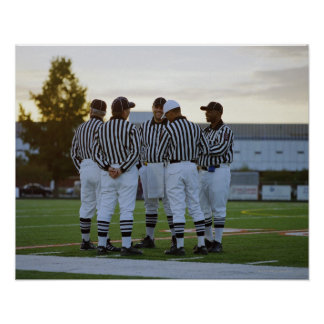 American football referees talking in field poster