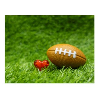 American Football with love on green grass soccer Postcard