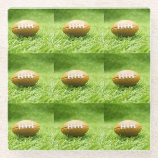 American Footballs are on green grass Glass Coaster