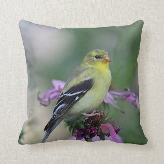 American goldfinch in the garden throw pillow