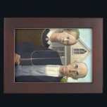 """American Gothic Painting by Grant Wood Memory Box<br><div class=""""desc"""">American Gothic Painting by Grant Wood: The iconic painting was inspired by the American Gothic House or Dibble House,  a small white house in Iowa built using Carpenter Gothic architecture,  and Wood&#39;s idea of the type of people who should live there.</div>"""