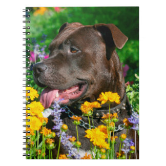 American Pit Bull in field of flowers Spiral Notebook