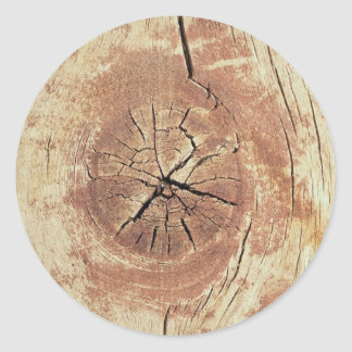 American west, knot in weathered wood round sticker
