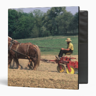 Amish Country simple people in farming with Binder