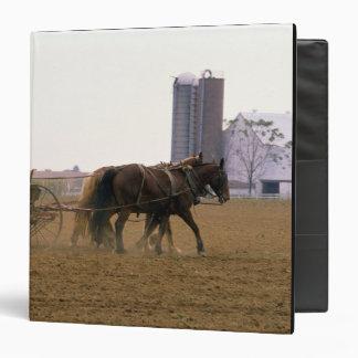 Amish farmer using a horse drawn seed planter 3 ring binders