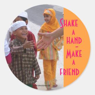 Amistad del mundo pegatina redonda