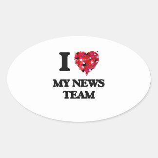 Amo a mi equipo de noticias pegatina ovalada