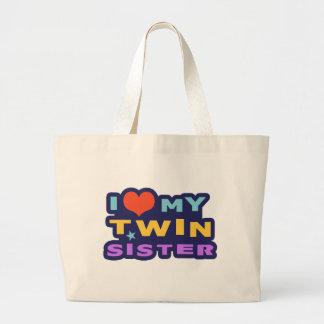 Amo a mi hermana gemela bolsas de mano