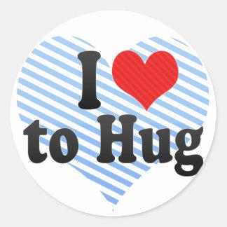 Amo abrazar pegatina redonda