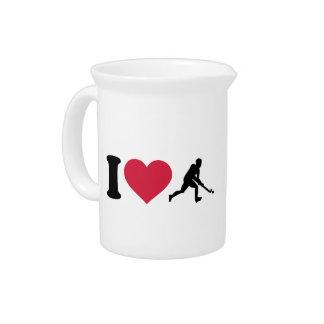 Amo al jugador de hockey hierba jarra