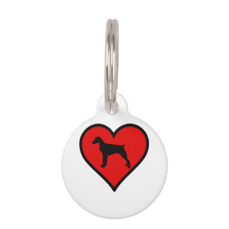 Amo el corazón del rojo de la silueta del perro