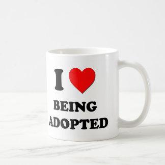 Amo el ser adoptado tazas