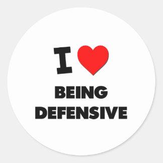 Amo el ser defensivo etiqueta redonda