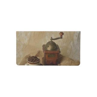 Amoladora y taza de café funda para chequera