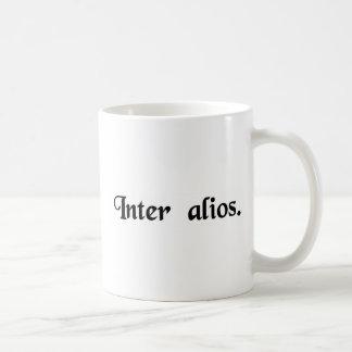 Amongst other people. coffee mug