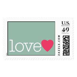 Amor con un corazón rosado brillante timbres postales
