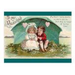 Amor debajo de un paraguas postal