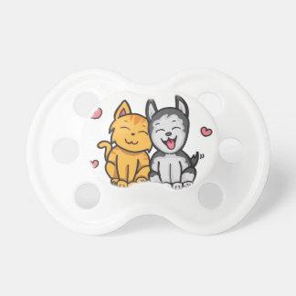 Amor del gato y del perro chupetes de bebé