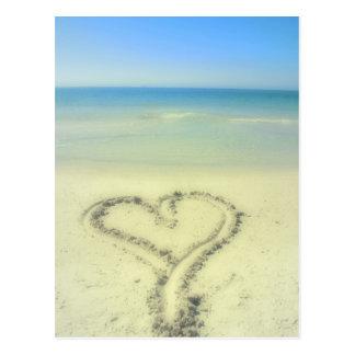 Amor en la playa postal