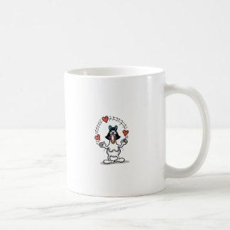 Amor imposible - el hacer juegos malabares del taza de café