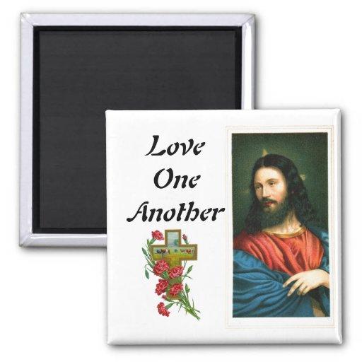 Amor uno otro con el imán de la imagen del Jesucri