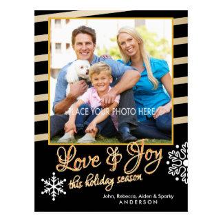 Amor y alegría, oro y navidad negro de la foto postales