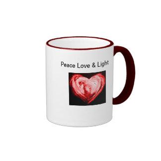 Amor y luz de la paz taza a dos colores