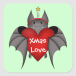 Amorous gothic Christmas bat with red heart Sticker