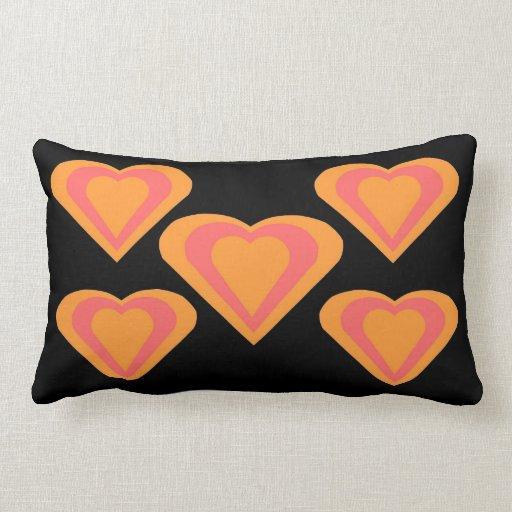 Amortiguador anaranjado y rosado de la almohada de