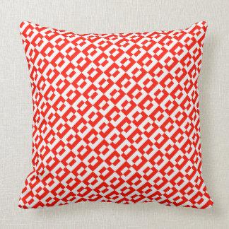 Amortiguador rojo y blanco en diseño de las tejas almohada