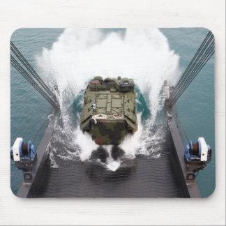Amphibious assault vehicles disembark from USNS Mouse Pad