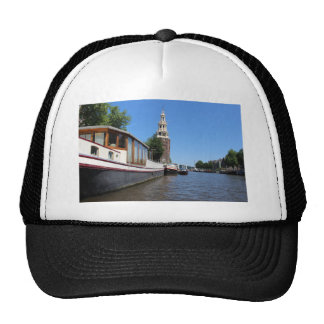 Amsterdam canal view - Boats and spire Trucker Hat