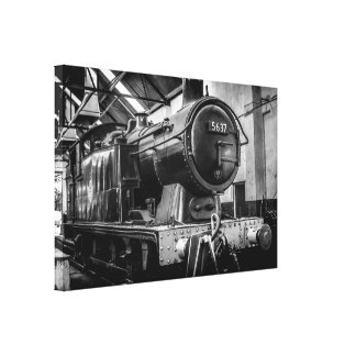 an 0-6-0 steam engine in the maintenance shed canvas print