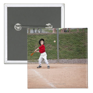 An action shot of a 5 year old baseball player pins