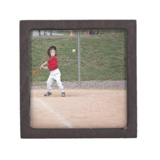 An action shot of a 5 year old baseball player jewelry box