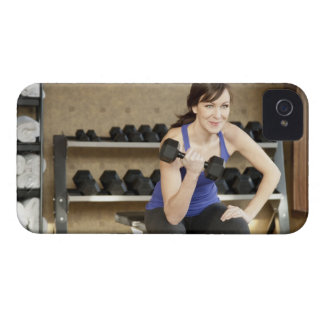 An active female lifting weights in a private iPhone 4 case